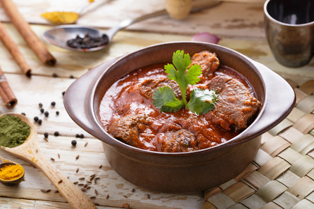 indian curry: portrait of spicy indian lamb rogan josh