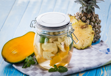 pineapple  glass: Summer fresh fruit Flavored infused water mix of mango and mint leaf
