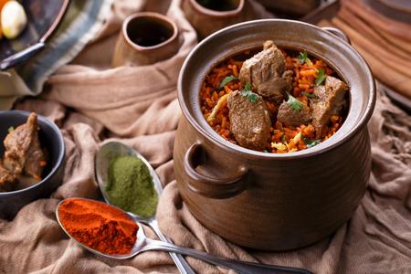 biryani: portrait of indian dum biryani lamb served in a pot Stock Photo