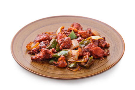 meat food: indian chili chicken with some veggies isolated on white background Stock Photo