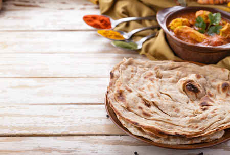 indian food: portrait of indian prata bread and chicken curry with copyspace
