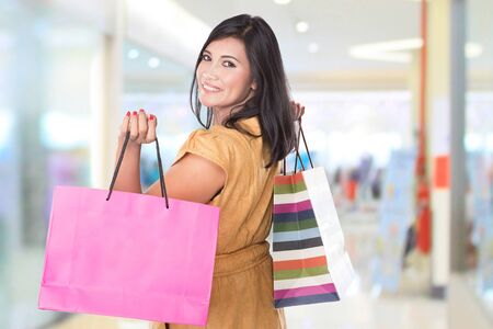 woman bag: A portrait of happy middle aged Asian woman holding shopping bags