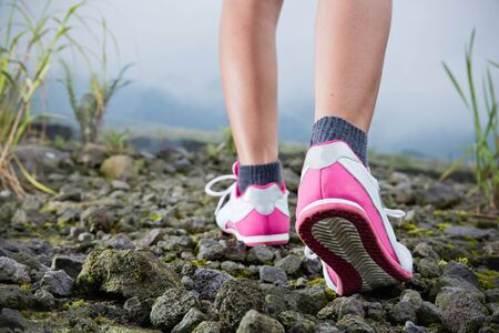 rocky road: A portrait of trekking on the rocky road, foot close up Stock Photo
