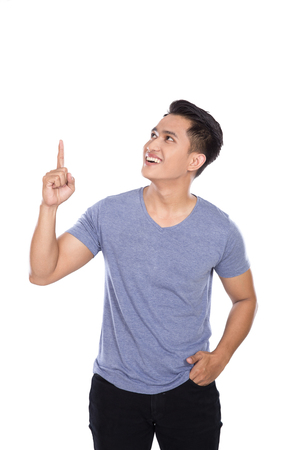 pointing finger up: A portrait of a young asian man getting an idea hand gesture. pointing up to copy space Stock Photo