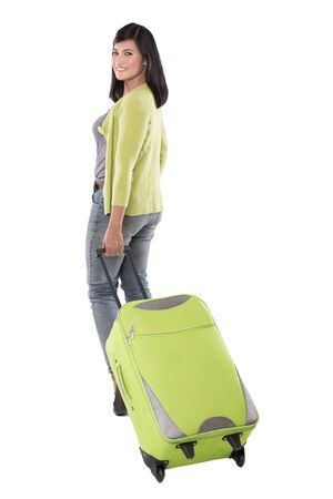 overseas: A portrait of beautiful middle aged asian woman holding suitcase and walking ready to go on vacation