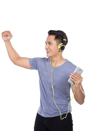 music listening: A portrait of Young asian man listening to music with a headset