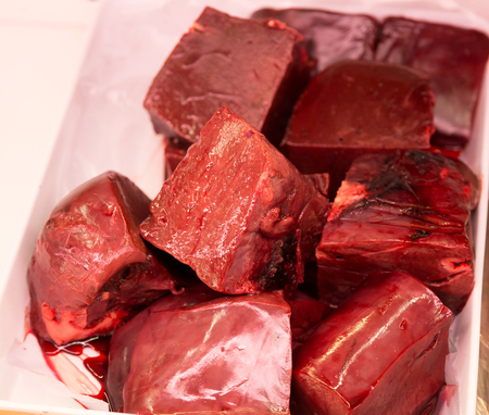 lean over: A Close up portrait of Beef liver in white plastic tray Stock Photo