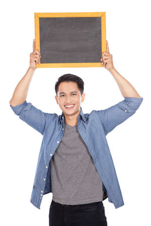 young asian: A portrait of happy young asian man holding blackboard on white background
