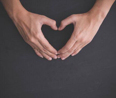 love shape: portrait of Hands making heart shape, hand gesture