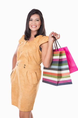 pan asian: A portrait of happy Asian woman holding shopping bags