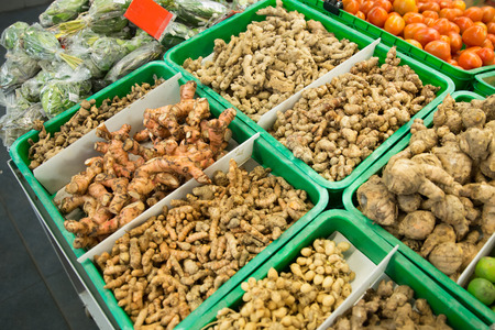 volatile: A portrait of turmeric root and other herbs for alternative medicine ,spa products and food ingredient, in a market stall Stock Photo