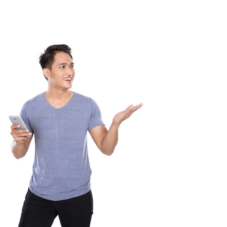A portrait of an Asian young man holding a hanphone, presenting hand gesture