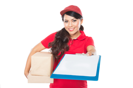costumer: Portrait of Female delivery service happily delivering package to costumer Stock Photo