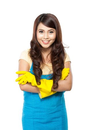 latex woman: A portrait of a Young asian woman getting ready to do the chores, putting on yellow latex gloves