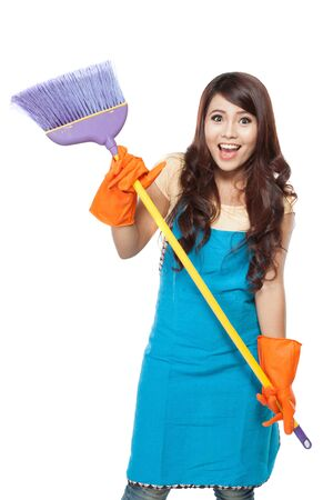 house maid: A portrait of a beautiful young asian woman posing hold onto a broom, while smiling to the camera. isolated over white background