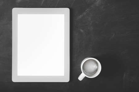 touchpad: top view blank screen touchpad and coffee cup with copy space on black board for background