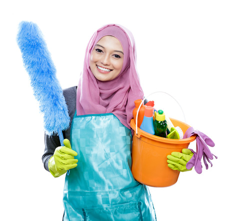 house maid: portrait smiling cleaner young woman wearing hijab with copy space isolated on white background Stock Photo