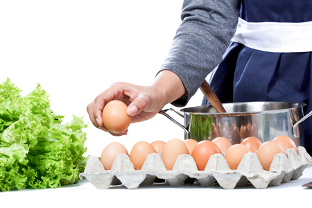 'pick up': close up portrait of hands of housewife pick up an egg preparing for making meal Stock Photo