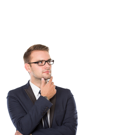 businessman thinking: portrait of Businessman thinking seriously, finger on his chin. ready for your design Stock Photo