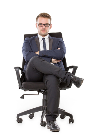 portrait of young businessman sitting on a chair. looking at camera. isolated over white background Foto de archivo