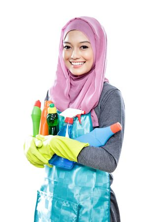 bright housekeeping: portrait of young housewife carrying many bottles of cleaning fluid isolated on white Stock Photo
