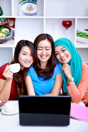 roommates: portrait of happiness in a friendship between three beautiful women Stock Photo