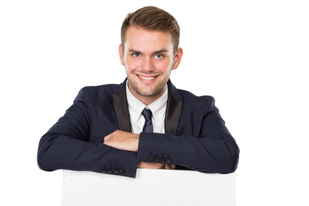 over white: portrait of Businessman with a blank white billboard, smiling. isolated over white background