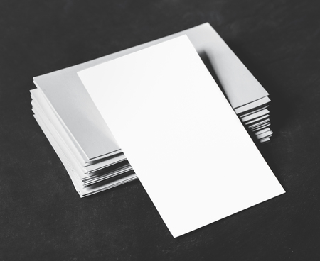 businesscard: portrait of blank business cards on the stack with black board for background