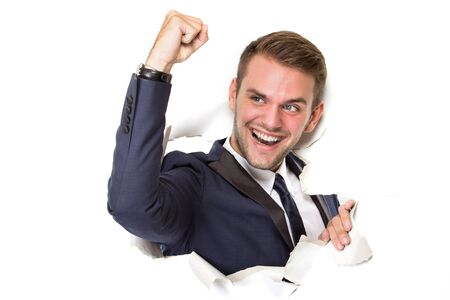 hand paper: portrait of Happy successful Businessman ripped white blank board