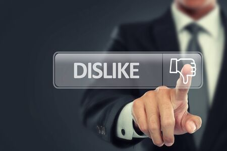 at button: portrait of Businessman push to dislike button on virtual screen