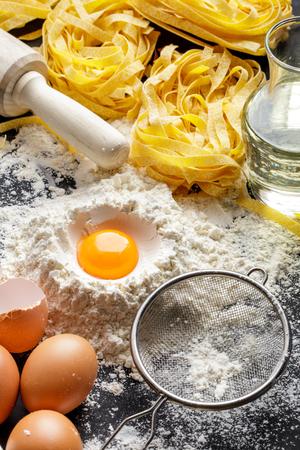 preparation: portrait of raw homemade fettucine with ingredients Stock Photo