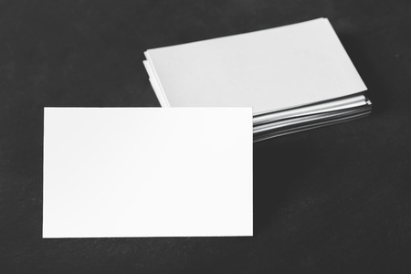 businesscard: close up portrait of stack of business cards with black board for background