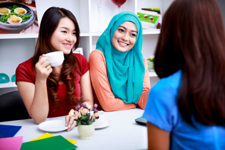 classmates: portrait of a group of women have an interesting conversation at living room Stock Photo