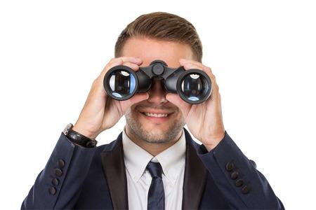 viso uomo: ritratto di affari con un binocolo, sorridente, concettuale. pronti per la progettazione Archivio Fotografico
