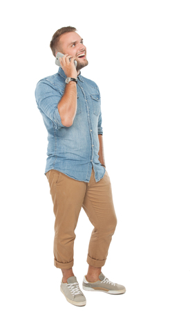 well build: portrait of young man talking on the phone, look up, smiling. isolated over white background Stock Photo