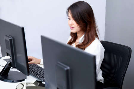 asian businesswoman: portrait of beautiful employee look serious when working