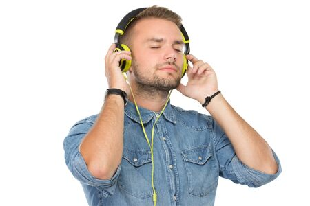 potrait: Potrait of young man listening music through a headset Stock Photo