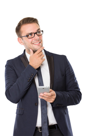 well build: portrait of Businessman grinning, finger in chin, holding a cellphone. isolated over white background Stock Photo