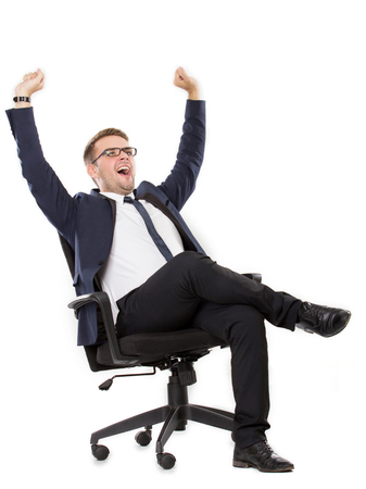 in need of space: portrait of Businessman yawning, both hands up leg crossed. ready for your design Stock Photo