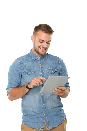 young man portrait: portrait of young man using a tablet pc, isolated. ready for your design