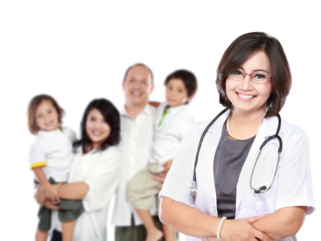 Smiling medical doctor with stethoscope, in front of her patient .Isolated over white background
