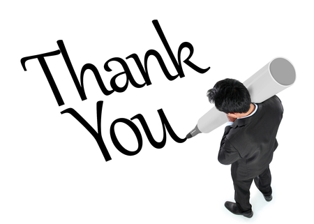 acknowledgment: Man in suit writing thank you in  white background, conceptual