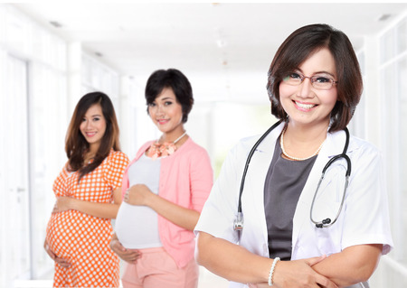 asian pregnant: portrait of Smiling obstretricians with stethoscope with her patient Stock Photo