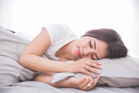 peacefully: portrait of Woman sleeping peacefully on a bed