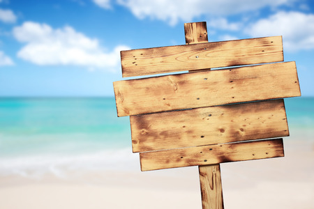 wood board: A portrait of a vintage rustic wooden sign on the beach Stock Photo