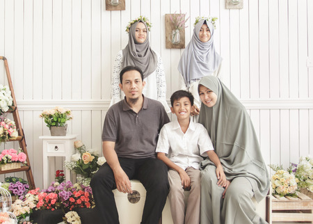 portrait of happy family on decorated room