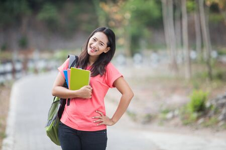 young asian: A portrait of a young Asian students outdoor, posing cutely to the camera
