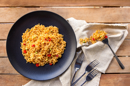 fried: top view portrait of spicy indonesian fried noodle with fork and napkin Stock Photo