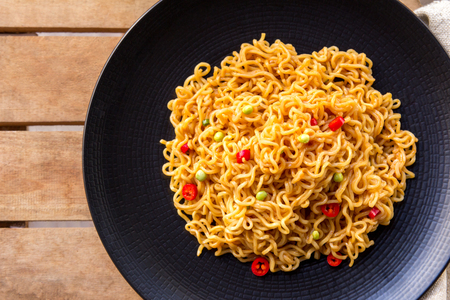 fried noodle: top view of spicy indonesian fried noodle with fork and napkin Stock Photo