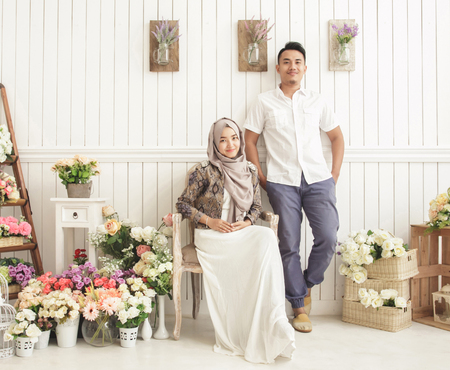 portrait of happily married couple at decorated room